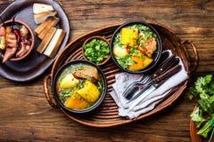 Latin American food. Traditional chilean pork soup cazuela. Cazuela Chilena Stock Image