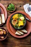 Latin American food. Traditional chilean pork soup cazuela. Cazuela Chilena Stock Photography