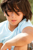 Kid With Problems. A Latin american little boy staring away Royalty Free Stock Photo