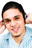 Latin American Man Listening To Headphones Royalty Free Stock Images