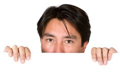 Latin american man peeping over white card Royalty Free Stock Photos