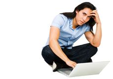 Latin American man using a laptop Royalty Free Stock Photography