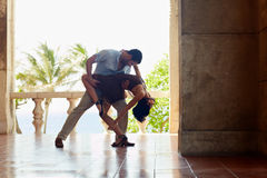 Latin american man and woman dancing. Young hispanic couple dancing latin american dance outdoors. Horizontal shape, side view, full length stock photo