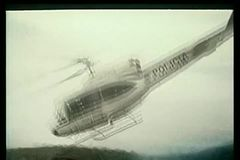 Latin American police helicopter taking off in valley stock footage