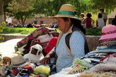 Latin american woman from Argentina sell souvenirs. Latin american indian woman from Argentina sell souvenirs. Salta, Quebrada de Humahuaca small mountain Royalty Free Stock Images