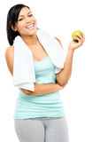 Latin american woman holding green apple Stock Photos