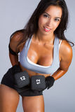 Latin American Woman Lifting Weights Stock Photos