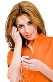 Latin American woman listening music Royalty Free Stock Image