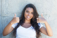 Latin american woman with long hair showing both thumbs up Stock Photography