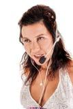 Latin-Amerikan kvinna med en hörlurar med mikrofon Fotografering för Bildbyråer