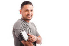 Latin athlete finding his favorite playlist Royalty Free Stock Photography