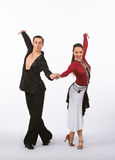 Latin Ballroom Dancers with Black and Red Dress - Arms Up Stock Photos