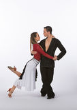 Latin Ballroom Dancers with Black and Red Dress - Lean Stock Image