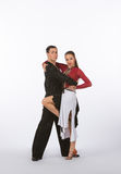 Latin Ballroom Dancers with Black and Red Dress - Leg Lifted Royalty Free Stock Photo