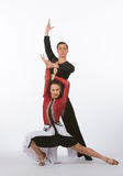 Latin Ballroom Dancers with Black and Red Dress - Posing Stock Photo