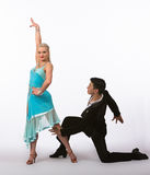 Latin Ballroom Dancers with Blue Dress - Arm Lifted Royalty Free Stock Photo