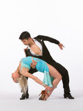 Latin Ballroom Dancers with Blue Dress - Back Bend Royalty Free Stock Photography