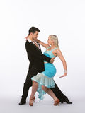 Latin Ballroom Dancers with Blue Dress - Romance Royalty Free Stock Photography