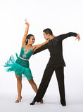 Latin Ballroom Dancers with Green Dress - Arms Up Stock Photography