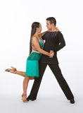Latin Ballroom Dancers with Green Dress = Leg Up Royalty Free Stock Photo