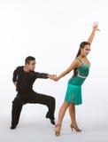 Latin Ballroom Dancers with Green Dress - Sit Back Stock Photography