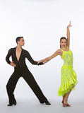 Latin Ballroom Dancers with Neon Yellow Dress - Arm Raised Royalty Free Stock Photos