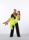 Latin Ballroom Dancers with Neon Yellow Dress - Lifted Royalty Free Stock Photos