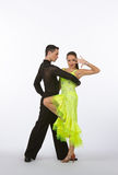 Latin Ballroom Dancers with Neon Yellow Gown Royalty Free Stock Photography