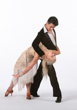 Latin Ballroom Dancers with Off-White Dress - Bent Back Royalty Free Stock Images