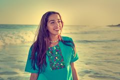 Latin beautiful girl in Caribbean beach sunset. With embroidery dress Royalty Free Stock Images