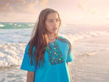 Latin beautiful girl in Caribbean beach sunset Royalty Free Stock Photos
