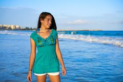 Latin beautiful girl in Caribbean beach sunset. With embroidery dress Stock Image
