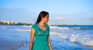 Latin beautiful girl in Caribbean beach sunset. With embroidery dress Royalty Free Stock Photography