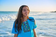 Latin beautiful girl in Caribbean beach sunset. With embroidery dress Royalty Free Stock Photos