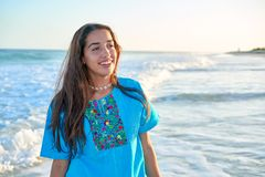 Latin beautiful girl in Caribbean beach sunset. With embroidery dress Royalty Free Stock Image