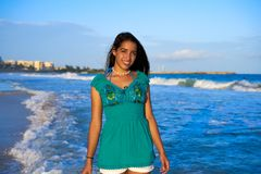 Latin beautiful girl in Caribbean beach sunset. With embroidery dress Stock Photography