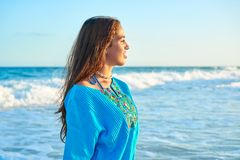 Latin beautiful girl in Caribbean beach sunset. With embroidery dress Stock Images