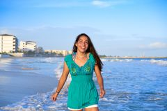 Latin beautiful girl in Caribbean beach sunset. With embroidery dress Royalty Free Stock Photo