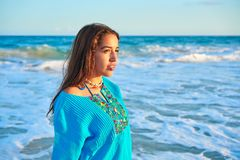 Latin beautiful girl in Caribbean beach sunset Royalty Free Stock Photography