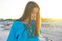 Latin beautiful girl happy in beach sunset. Latin beautiful girl happy in Caribbean beach sunset with embroidery dress portrait Stock Photo