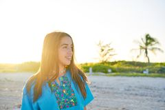 Latin beautiful girl happy in beach sunset. Latin beautiful girl happy in Caribbean beach sunset with embroidery dress portrait Stock Image
