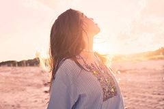 Latin beautiful girl happy in beach sunset Royalty Free Stock Photos