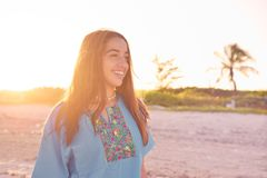 Latin beautiful girl happy in beach sunset Royalty Free Stock Photography