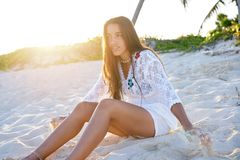 Latin beautiful girl sunset in Caribbean beach. Sand sitting relaxed Stock Photography