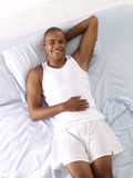 Latin bed. Young afro american relaxed on bed Royalty Free Stock Images