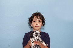 Latin Boy and a Dalmatian Puppy Stock Image