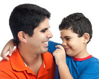 Latin boy hugging his father. Cute latin boy hugging and playing with his father isolated on white Stock Photos
