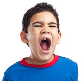 Latin boy screaming with anger Stock Photo