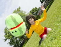 Latin Boy Throwing a Stuffed Toy Stock Images