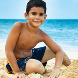 Latin boy on a tropical beach royalty free stock photo